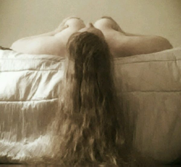 Woman with really long hair kink