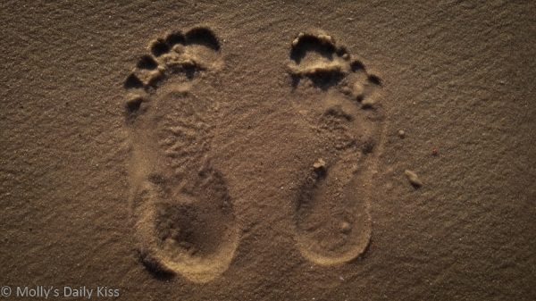 foot prints in the sand for kink of the week topic about feet