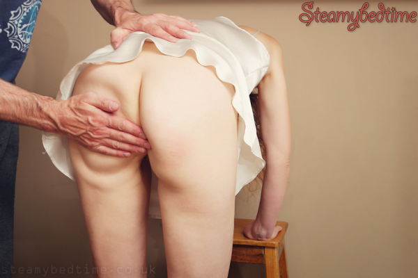 man spanking womans bottom