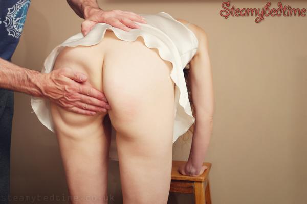 man spanking womans bottom