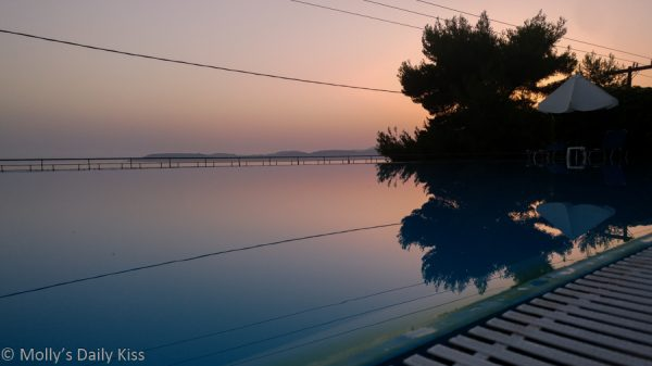 Sunset over swiming pool would be ideal spot for skinny dipping