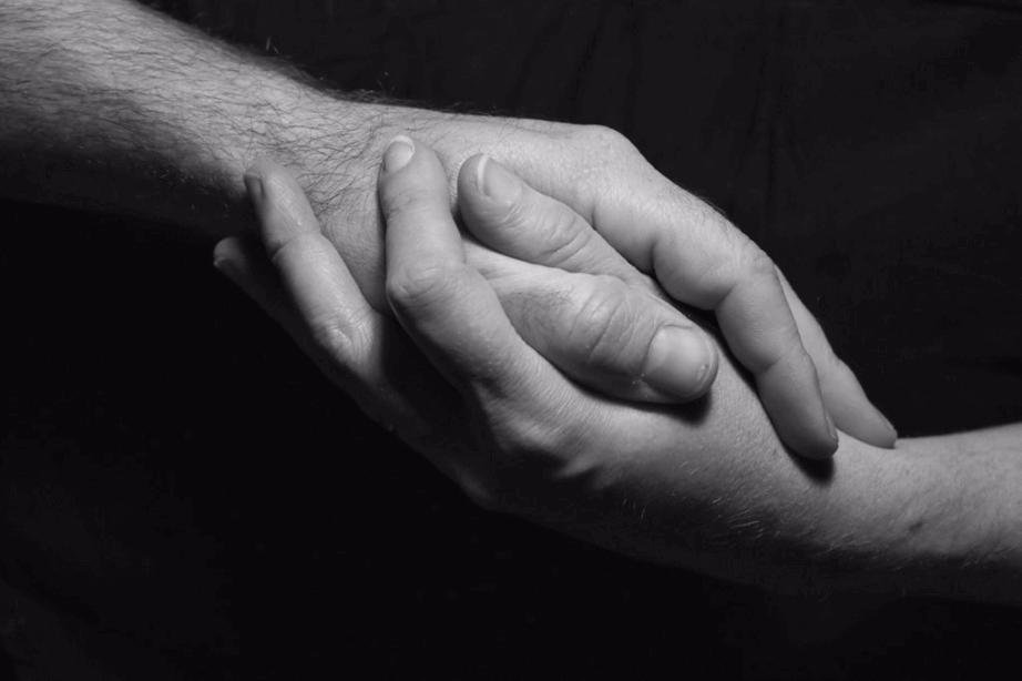 Male and female hands reaching for each other
