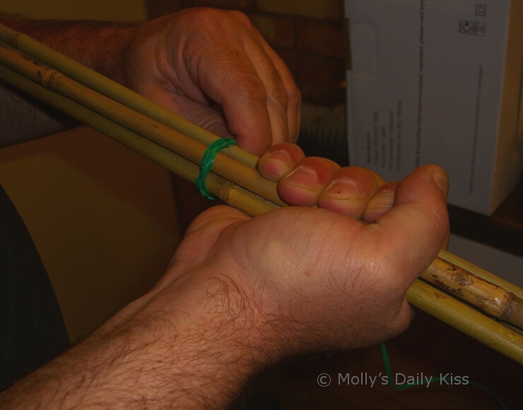 Man's hands making homemade cane