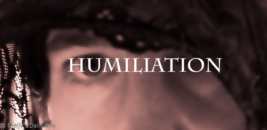 Blured face with the word humiliation over it.