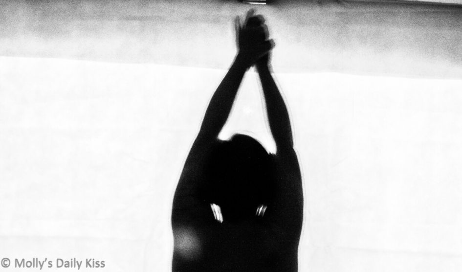 silhouette of woman holding her hands above her head for post about Honour Bondage