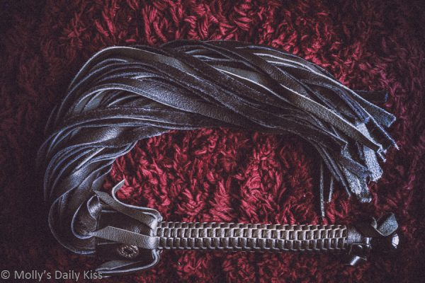 Black leather flogger for flogging
