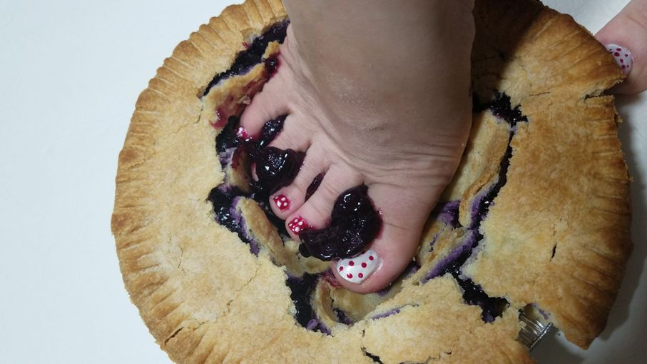 Woman pushing foot into fruit pie for post about sploshing